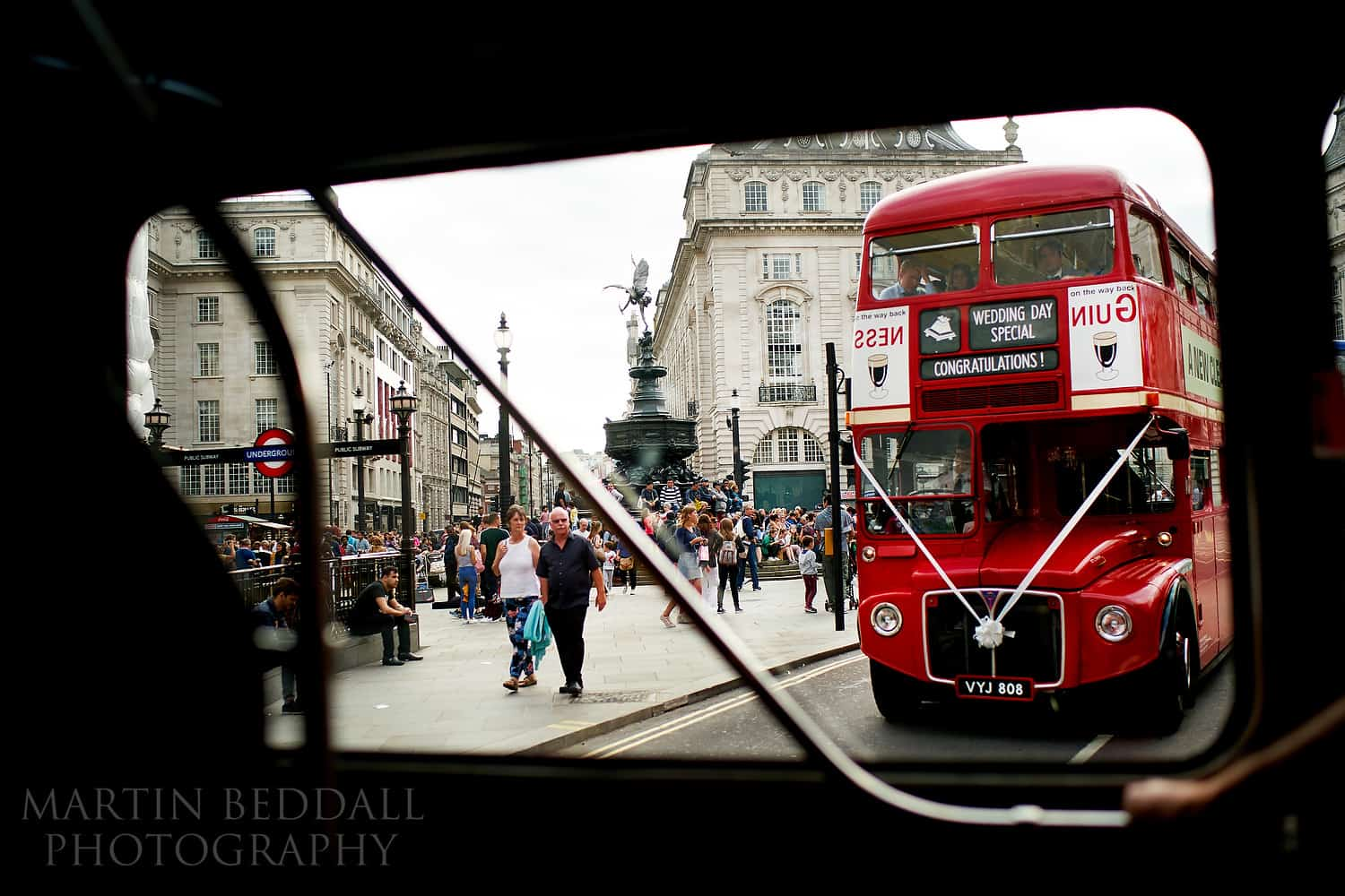 Wedding buses pass through Piccadilly Circus