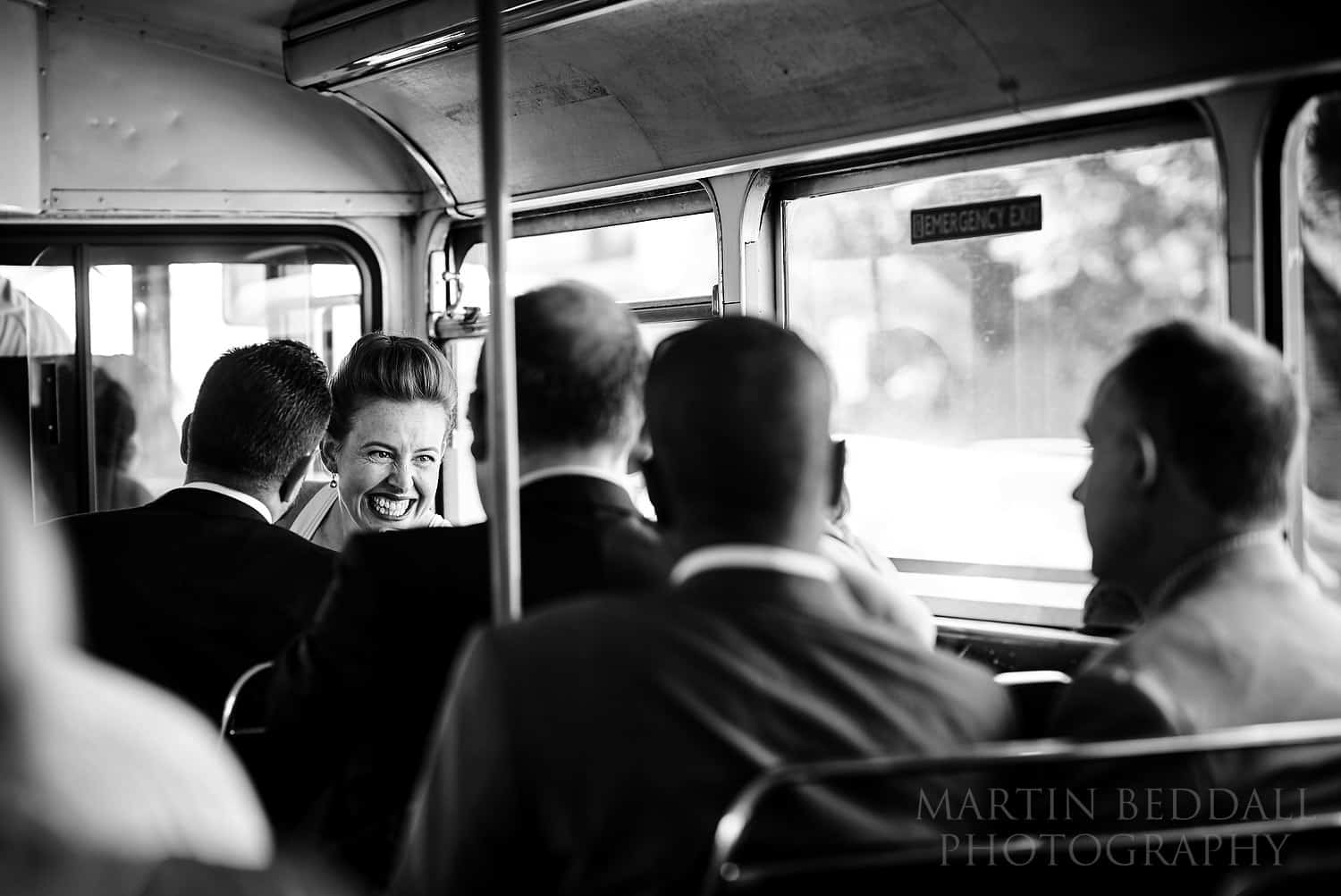 Bride chats with guests on the coach
