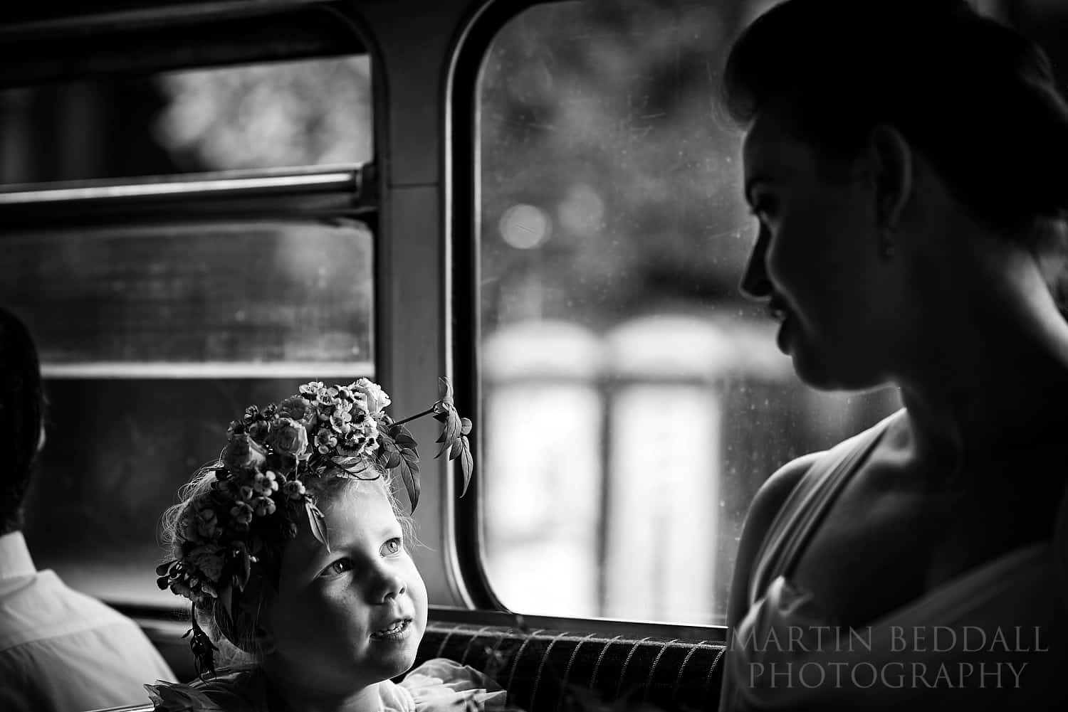 Flower girl and bride on the routemaster