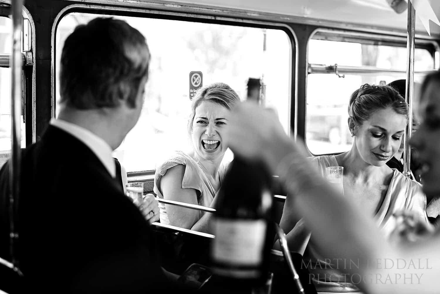 Champagne on the wedding bus