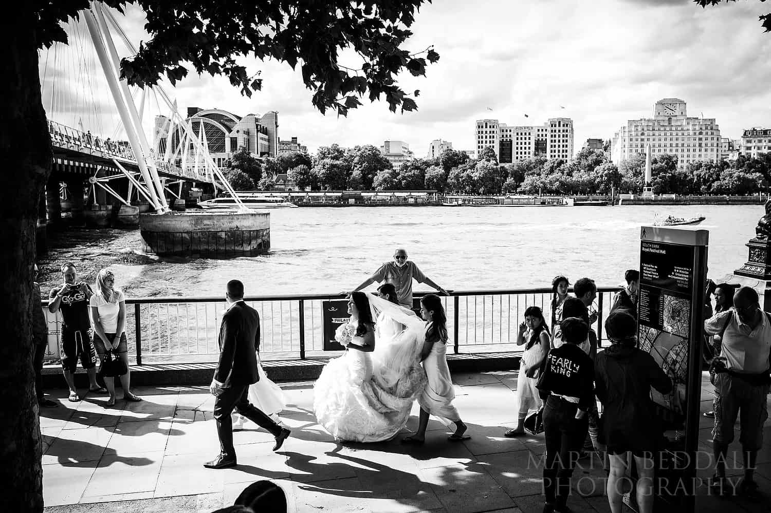Bride and groom on the South Bank in London heading to the reception venue