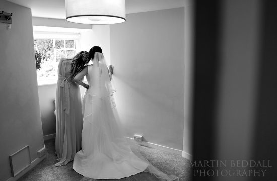 Quiet moment between bride and her sister.