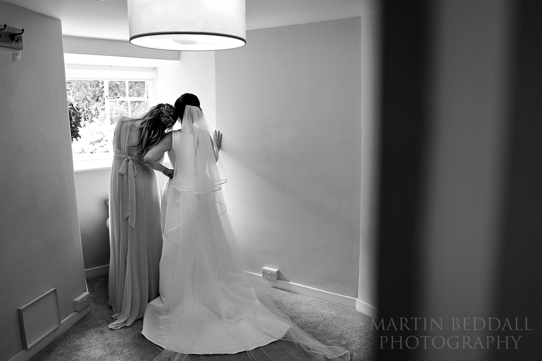 Quiet moment between bride and her sister.