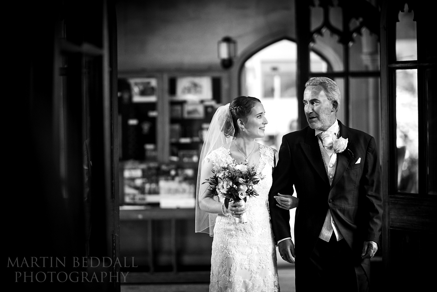 Bride and her father exchange looks before entering The Oxford chapel