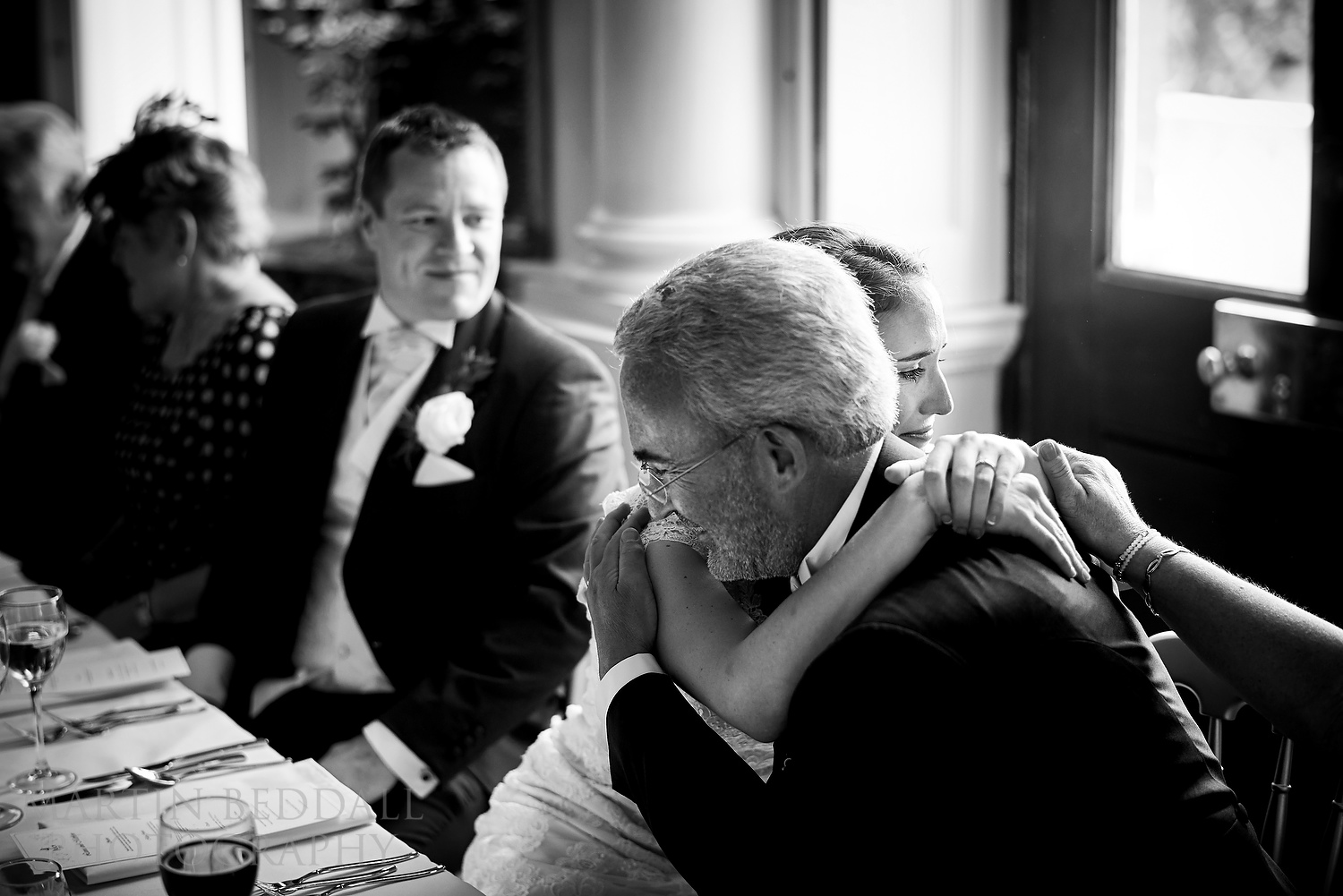 Bride hugs her father after his speech at Kirtlington Park