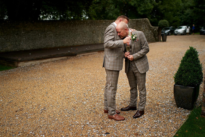 Two grooms at Cissbury Barns