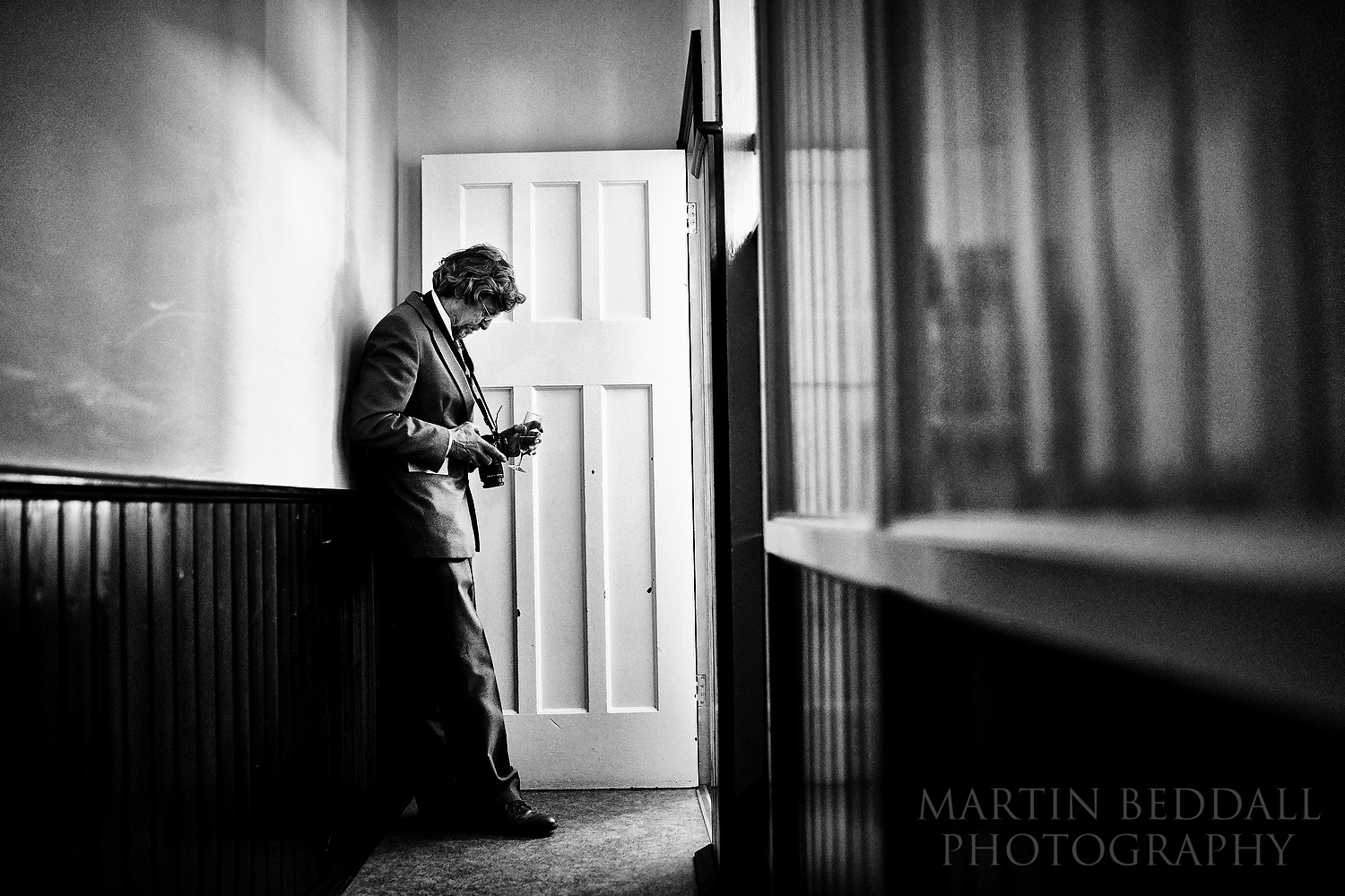 Wedding guest checking images on his camera