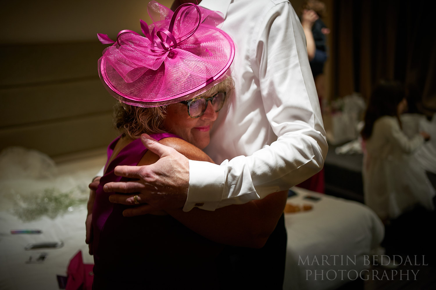 Bride's parents hug