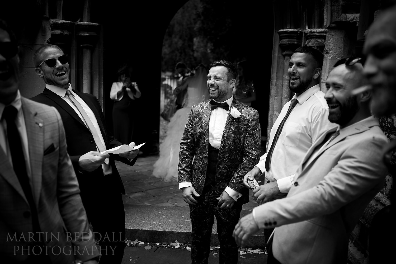 Groom jokes with his mates after the ceremony