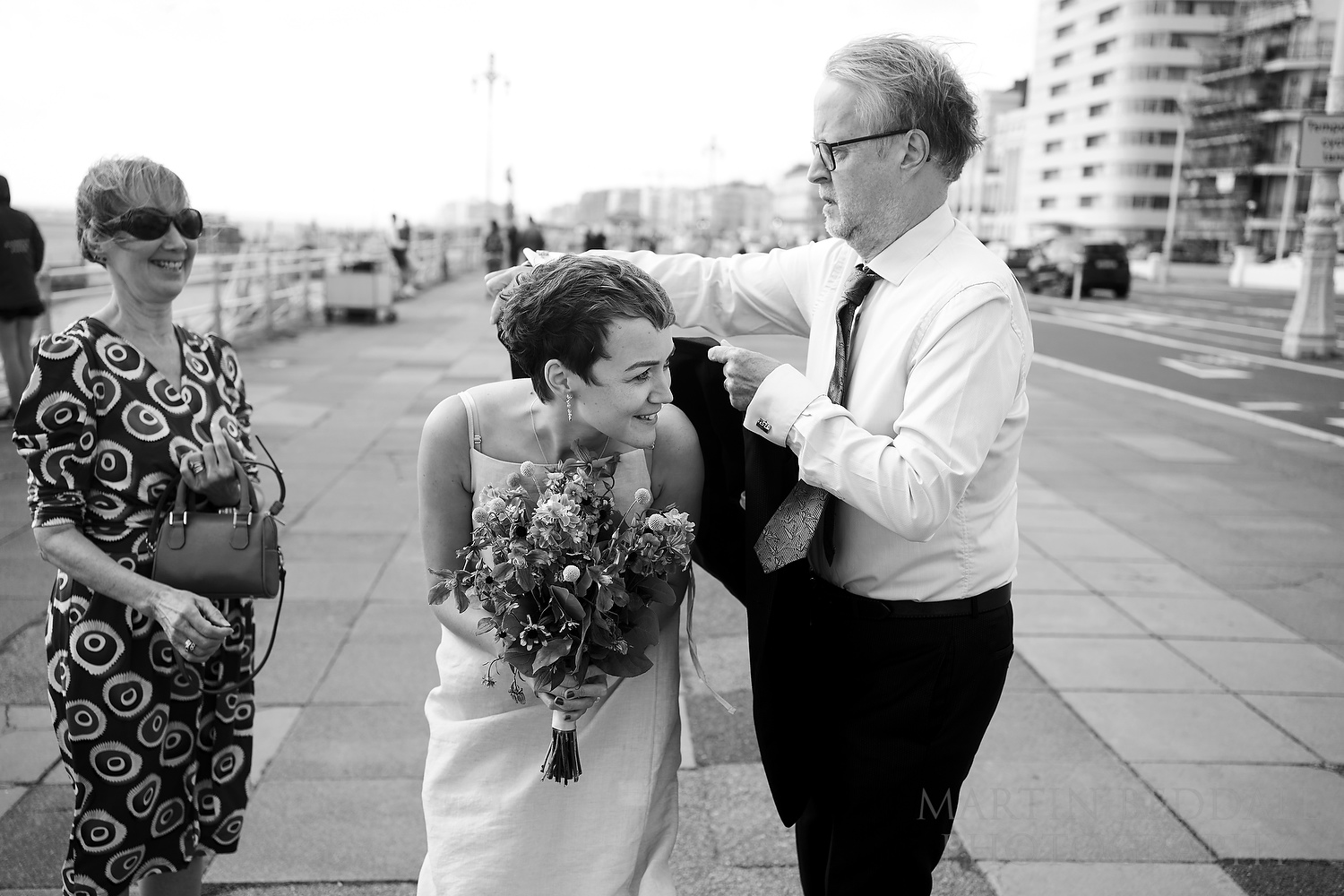 Bride's father offers his jacket