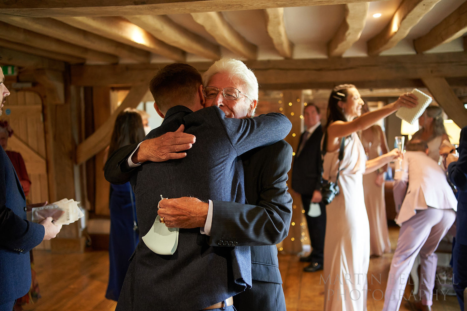 Groom gets a hug from his father before the wedding ceremony