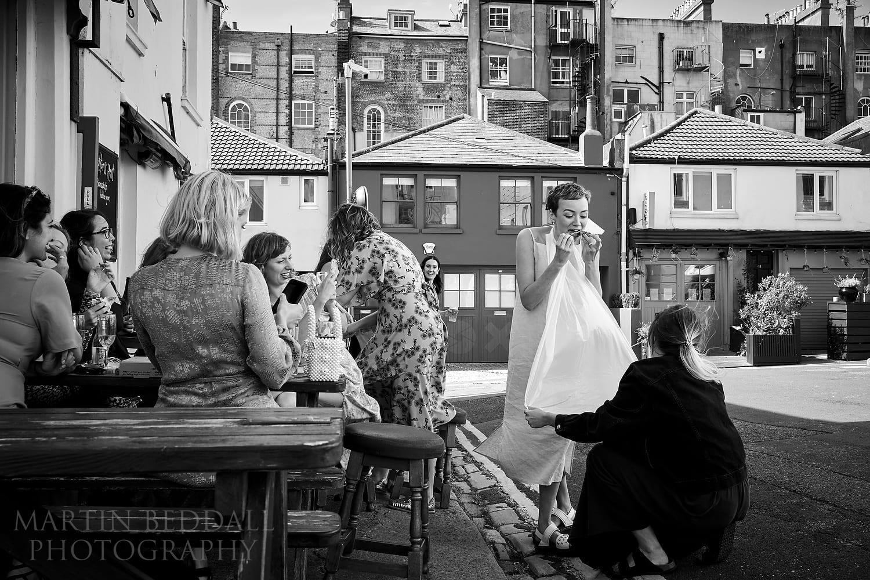 Bride eats pizza in Brighton