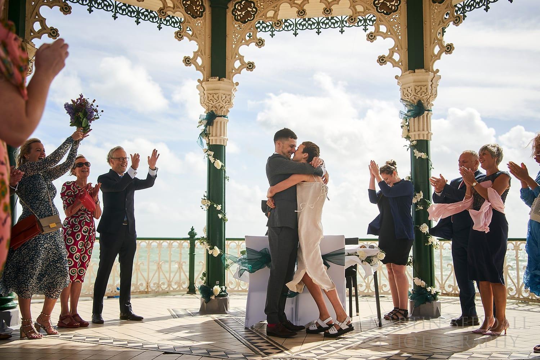Brighton wedding embrace