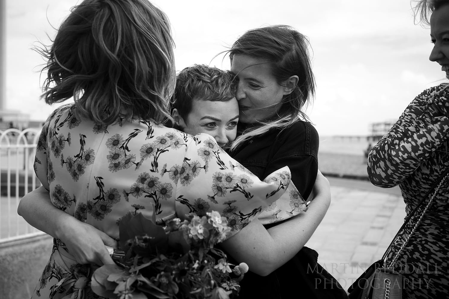 Bride hugged by her friends