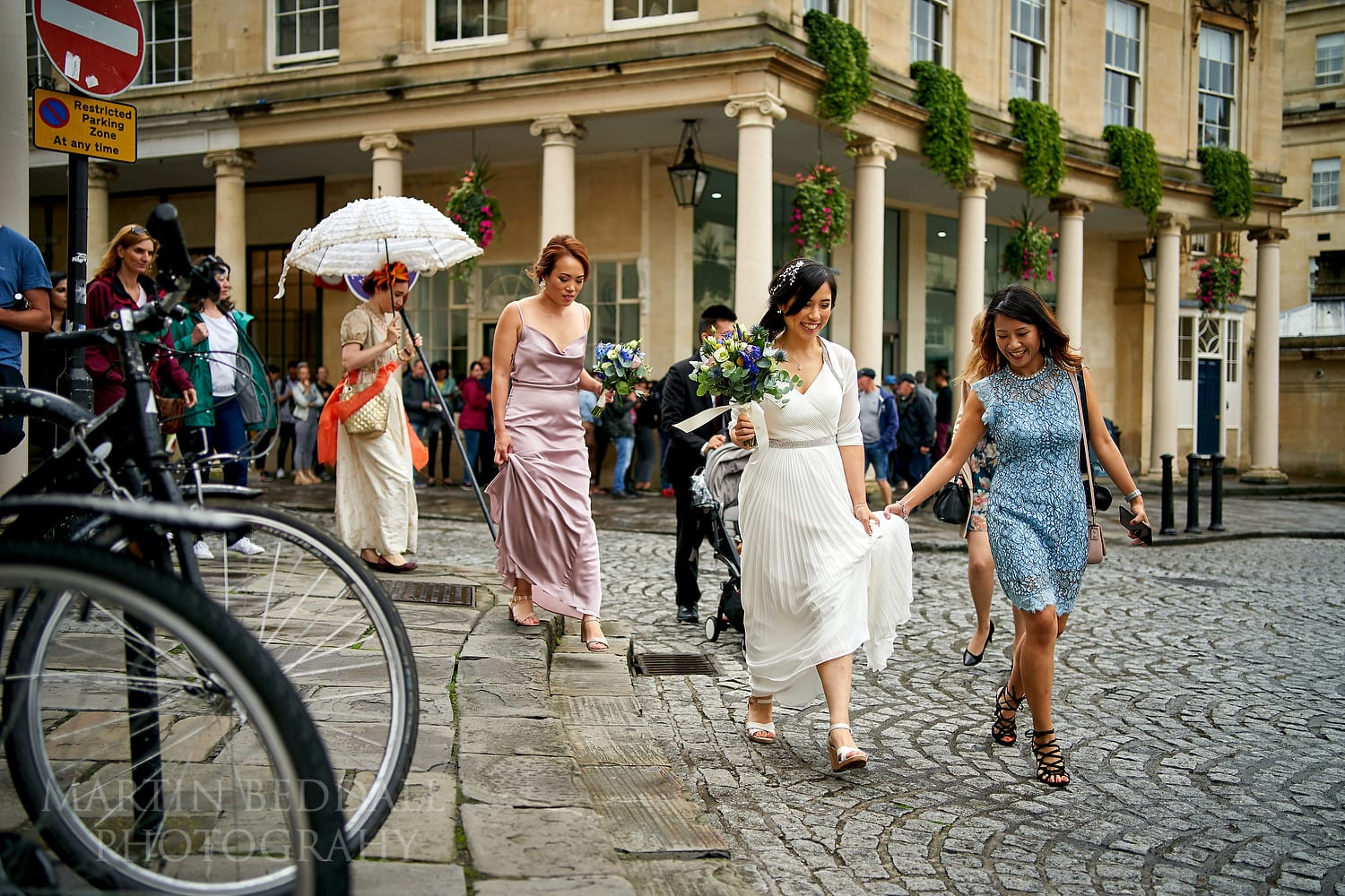Bride walking through Bath city centre