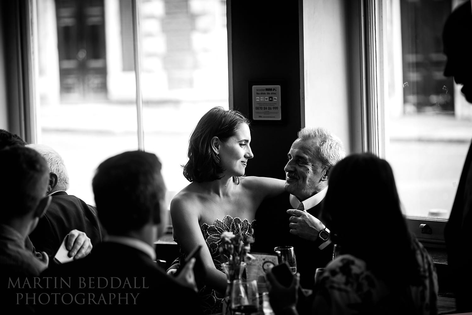 Bride and her father in London pub wedding reception
